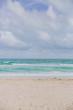 Miami beach by ocean under clouds in Miami, Florida, USA