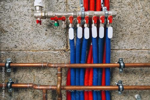 Fotografía  manifold collector with pipes in boiler room