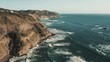 A panorama areal footage of the beautiful coasts in New Zealand on a sunset light. Rocky shores and cliffs with the waves crashing at them. Popular among surfers and water sports athletes.