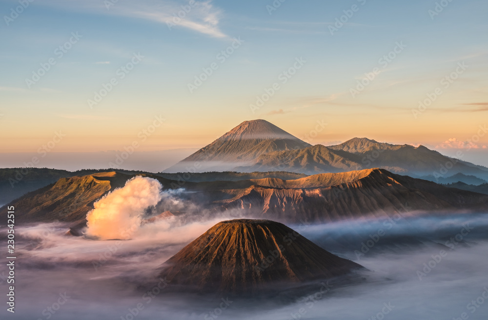 Fototapety, obrazy: Mount Bromo volcano (Gunung Bromo), and Batok during sunrise from viewpoint on Mount Penanjakan, in East Java, Indonesia. Early morning.