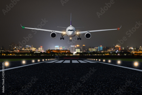 Airplane take off / landing at night with blurred town on background