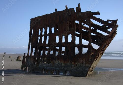 Foto op Canvas Schipbreuk Ship Wreak on the Beach
