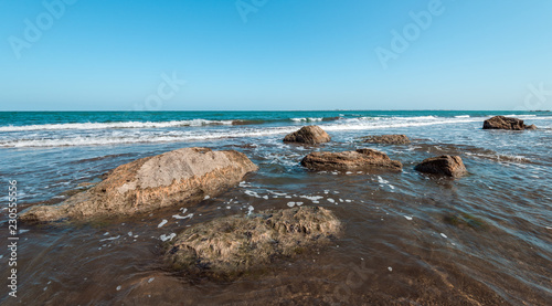Keuken foto achterwand Kust Rocky sea coast with turquoise water on the beach