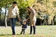 family with a baby in autumn park