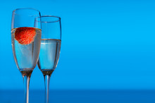 Pair Of Wine Glass With One Of Them With Strawberry