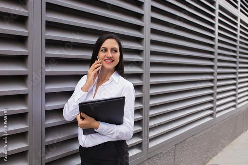 Portrait Of Happy Businesswoman Talking On Mobile Phone