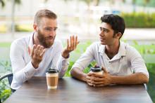 Two Male Friends Drinking Coff...