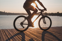Man Riding Bicycle At Sunset, ...