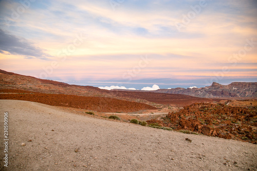 Foto op Canvas Wit Sunset above National Park Vulcan El Teide on Tenerife, Spain - Canary Islands. Blue sky, orange sand and rocks. Mountain landscape.