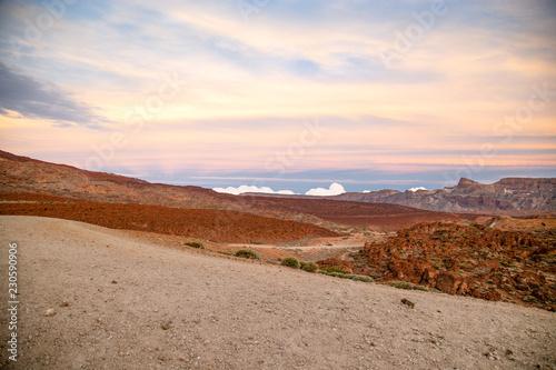 Foto op Plexiglas Wit Sunset above National Park Vulcan El Teide on Tenerife, Spain - Canary Islands. Blue sky, orange sand and rocks. Mountain landscape.