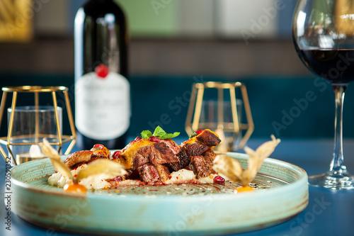 Deurstickers Klaar gerecht Delicious breast duck with mash potato and red wine on the table. Fine cuisine