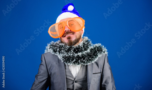 4173f9f0dc8 Man bearded hipster wear santa hat and funny sunglasses. Christmas party  organisers. Guy tinsel ready celebrate new year. Corporate party ideas  employees ...