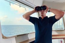 Portrait Of Navigator / Pilot / Officer On The Bridge Of The Vessel
