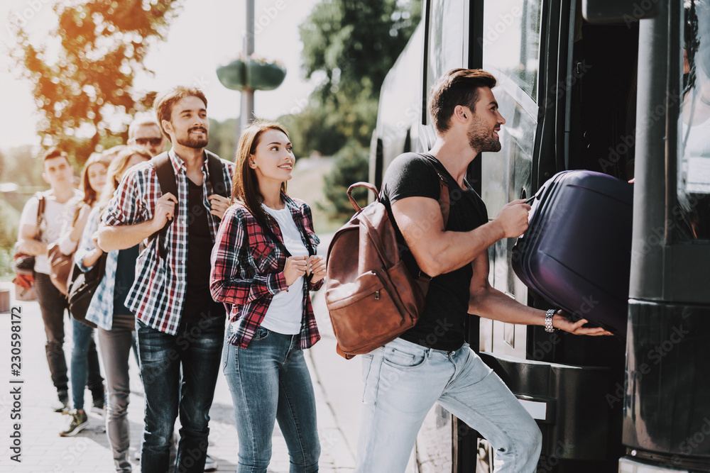 Fototapeta Group of Young People Boarding on Travel Bus