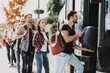 canvas print picture - Group of Young People Boarding on Travel Bus