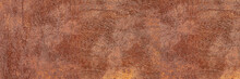 Panorama Of Rusty Metal Wall, Old Sheet Of Iron Covered With Ruфst And Corrosion Paint. Oxidized Iron Panel. Texture Or Background.