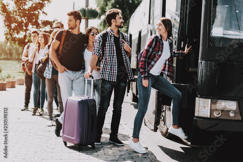 Fototapeta Group of Young People Boarding on Travel Bus obraz