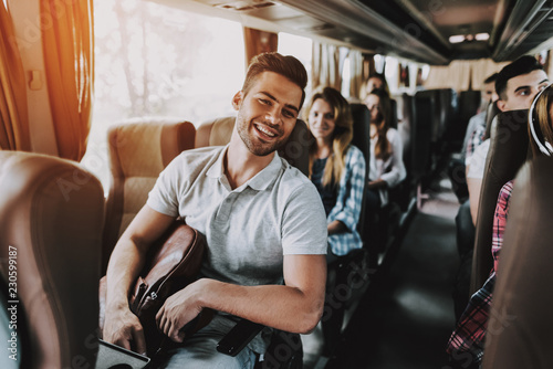 Obraz Young Handsome Man Relaxing in Seat of Tour Bus - fototapety do salonu