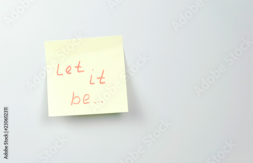 Photo  Note on yellow sticker paper sheets with motivation words let it be