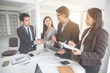 businesspeople meeting and discussing with graph and chart and showing successful result, and secretary making note using as background (concept of successful and achievement)