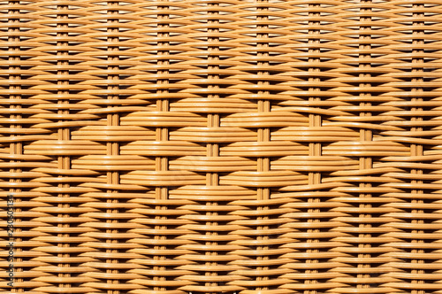 Fotografía  Closeup of decorated wicker basket or rattan chair textured background with desi
