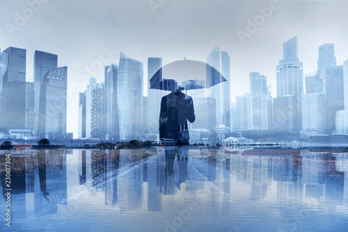 insurance concept, risk in business, businessman with umbrella double exposure Lerretsbilde