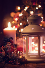 Christmas Lantern And Candle Under The Tree. New Year's Eve