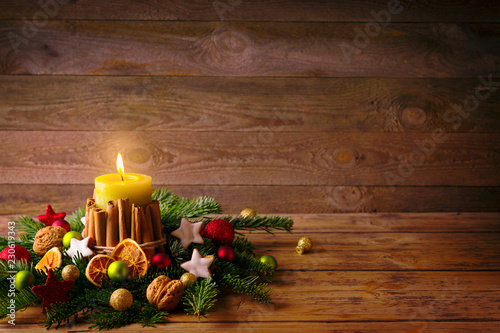 Natural Christmas background with burning candle