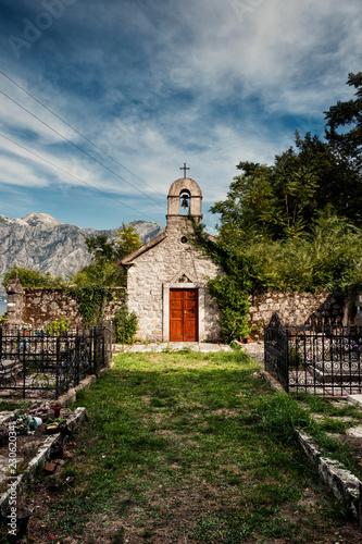 Foto op Canvas Begraafplaats Cemetery Church in the village of Donji Stoliv on Boka Kotorska, Montenegro