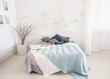 light, white, spacious bedroom with a large bed, in the Scandinavian style. Mockup and free space for text and pictures