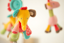 Carousel Of Children's Soft Colored Toys.