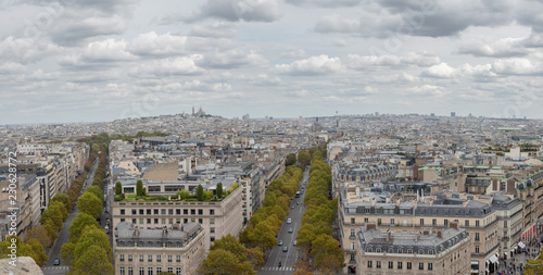Fotografie, Obraz  Aerial View of Downtown Paris Facing  the Sacre-Cœur Church with Cloudy Skies