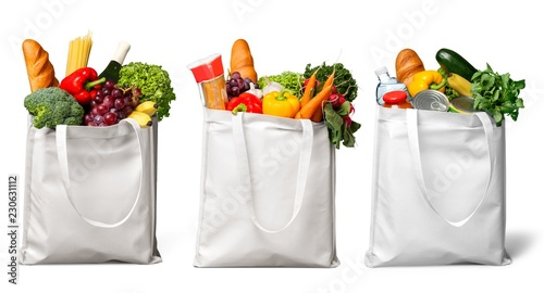 Fotografia Shopping bags with groceries isolated on white