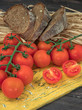 Fresh tomatoes from grapes on a wooden background. in a rustic style. season of vegetables. advertising.