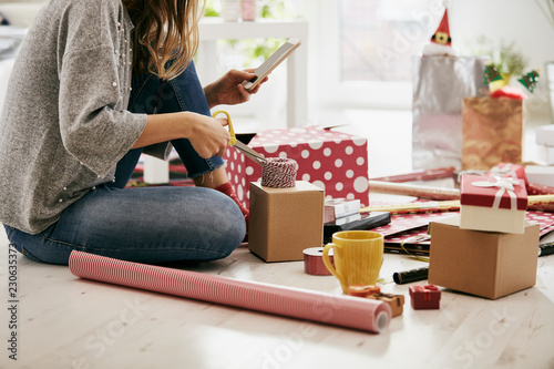 Woman preparing presents for family and friends for Christmas and New Year. Holiday concept.