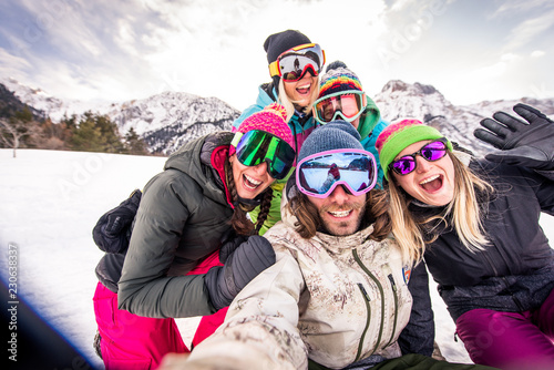 Fotografie, Obraz  Group of snowboarders on winter holiday
