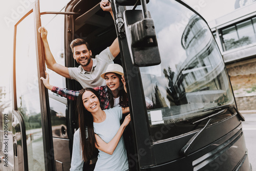 Young Smiling People Traveling on Tourist Bus