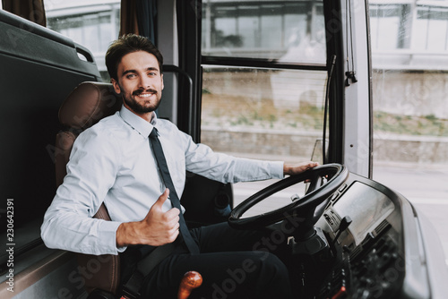 Fotografiet  Smiling Man Driving Tour Bus. Professional Driver