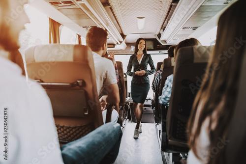 Female Tour Service Employee at Work on Tour Bus Slika na platnu