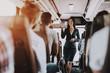 Leinwandbild Motiv Female Tour Service Employee at Work on Tour Bus