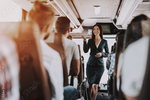 Tuinposter Female Tour Service Employee at Work on Tour Bus
