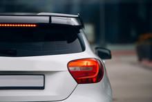 Rear View Of Modern Sport Hatchback. Carbon Spoiler On The Trunk Car