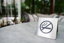 No Smoking Sign Made Of Stainless On Marble Table