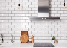 Modern Spacious Kitchen With White Brick Tile Wall.