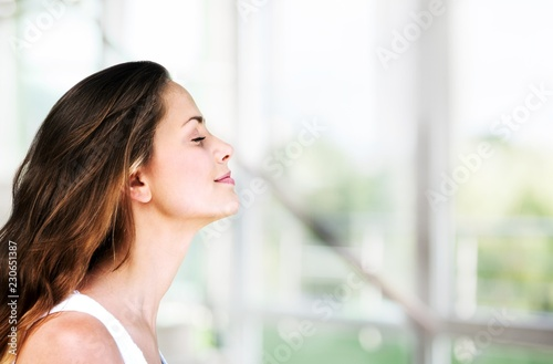 Young beautiful woman breathing outdoor with blurred
