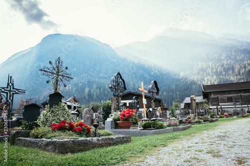 Cemetery, moutains and light rays in the background