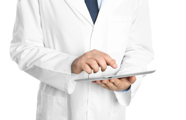 Male doctor holding modern tablet on white background, closeup