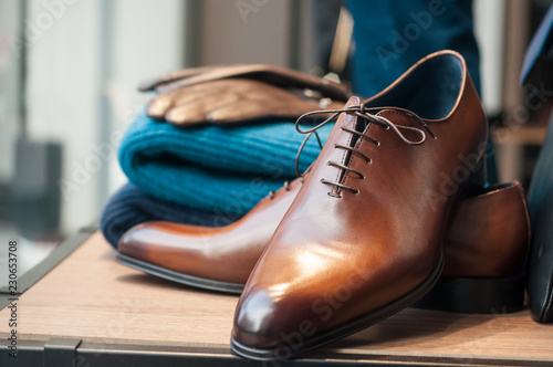 Obraz closeup of classic leather shoes for men in fashion store showroom - fototapety do salonu