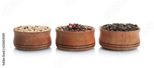 Keuken foto achterwand Aromatische Bowls with different kinds of pepper grains on white background