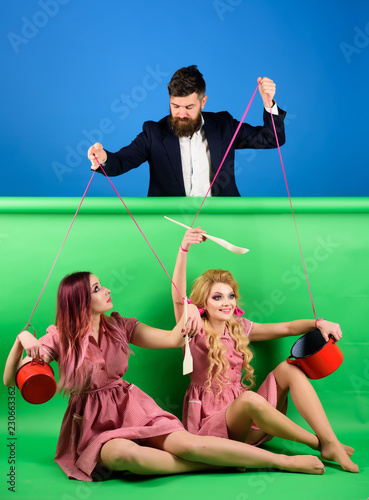 retro girls and master at party. Housewife. Creative idea. Love. Crazy girls and man. Halloween. vintage fashion women puppet and man. holidays and doll. dominance and dependence. Going crazy